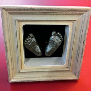 Box frame baby feet
